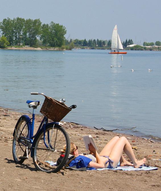 girl-reading-bike-beach-close-web