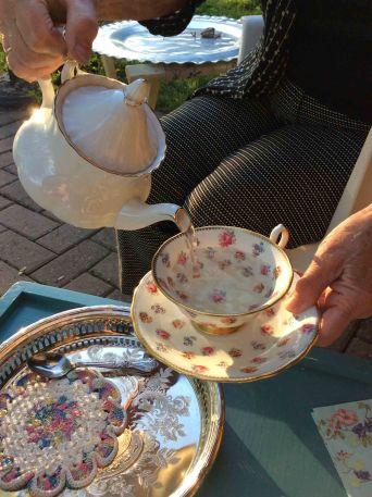 Pouring the cedar tea